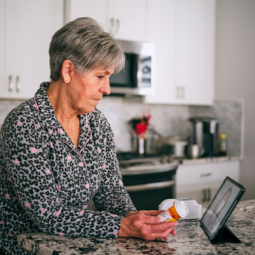 Older female on a virtual call with doctor